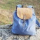 handmade backpack on the stone photographed close-up